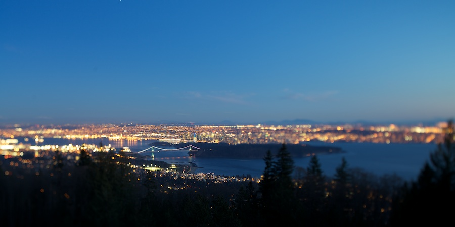 View of Vancouver lit up in evening glow. Cypress Mountain viewpoint, Vancouver, BC.