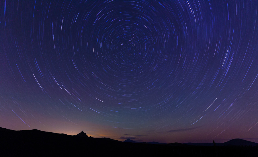 Star trails above the Deschutes National Forrest from Dee Wright Observatory. Mount Washington, Three Fingered Jack, and Black Butte are peaking on the horizon.