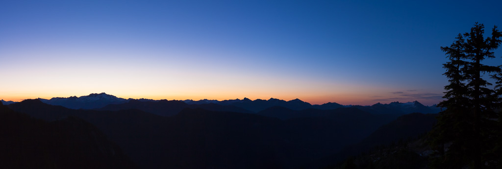 Sunrise from under the Sky Pilot mountain in Squamish, BC. Looking west over the Coast Mountain range, with Mamquam Mountain towering on the skyline