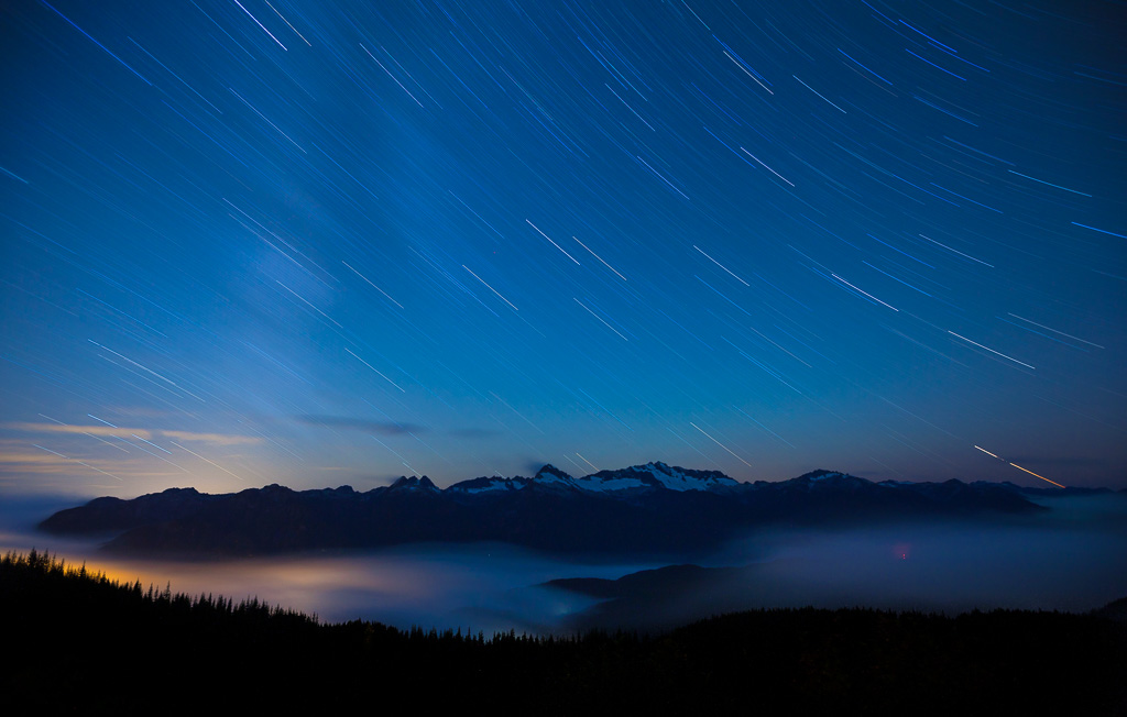 Faint outline of Milky Way over the Tantalus Range, with cloud filled Squamish Valley, BC.